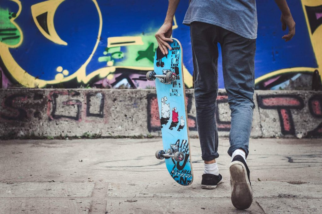 Skateboarding young person